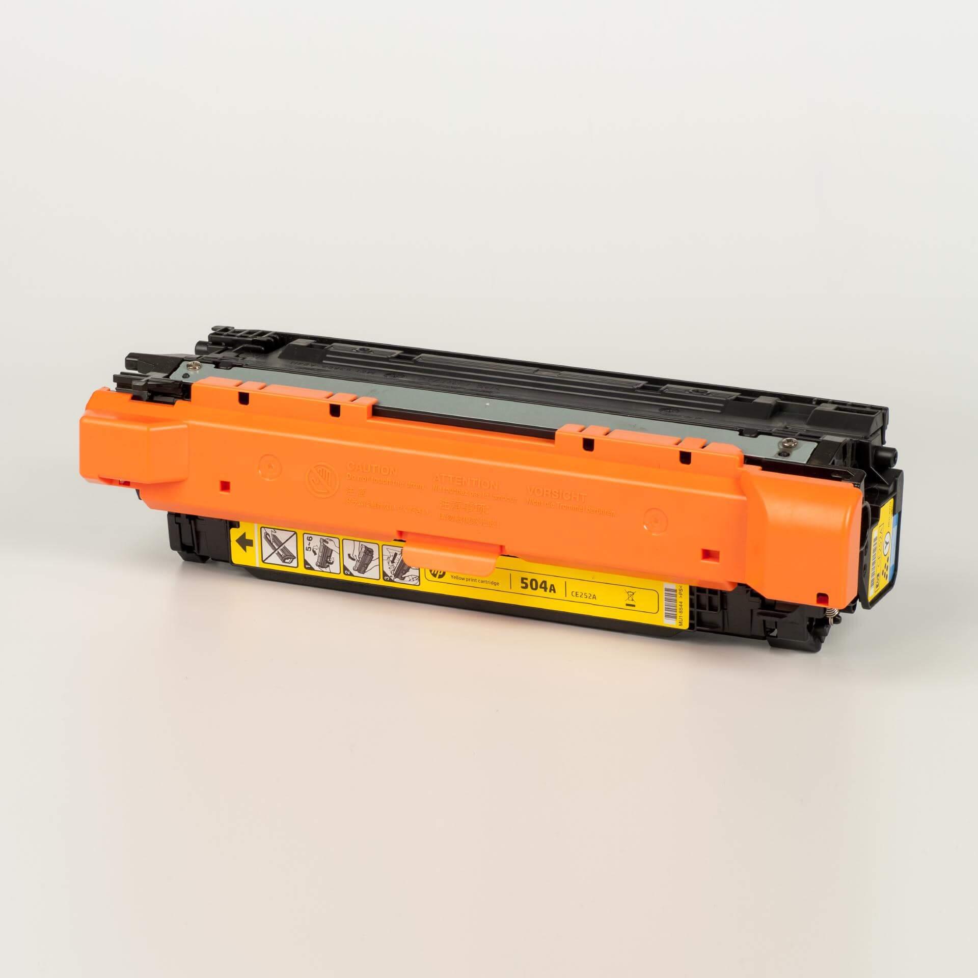 Auf dem Bild sehen Sie eine HP 504A (CE252A) Gelb Original Tonerkartusche