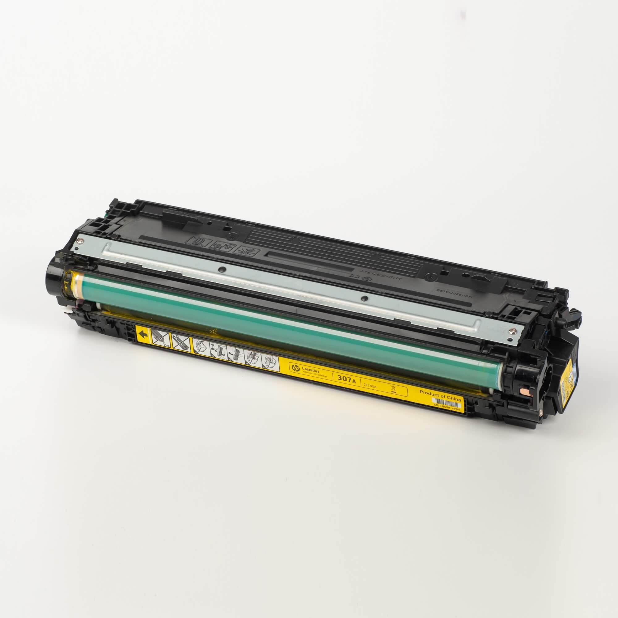 Auf dem Bild sehen Sie eine HP 307A (CE742A) Gelb Original Tonerkartusche